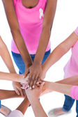 Group wearing pink and ribbons for breast cancer putting hands t — Stock Photo
