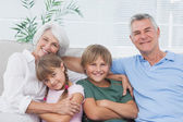 Portrait of grandparents with their grandchildren — Stock Photo