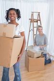 Young friends moving into new home — Stock Photo