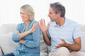 Man pleading with his wife after an argument — Stock Photo