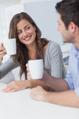 Cheerful couple drinking a cup of coffee — Stock Photo