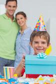 Little boy holding his birthday gift — Stock Photo