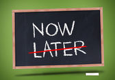 Now and later written on blackboard — Stock Photo
