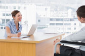 Businesswoman smiling at disabled job candidate — Stock Photo
