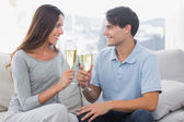 Lovers clinking their flutes of champagne — Stock Photo