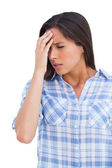 Woman with a headache and hand on forehead — Stock Photo