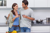 Couple clinking their glasses of red wine — Stock Photo