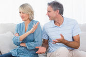 Man pleading with his wife after a fight — Stock Photo