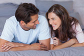 Man and woman lying on bed — Stock Photo