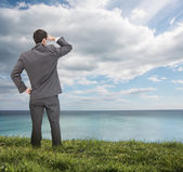 Stylish businessman looking at the sea — Stock Photo