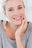 Pretty blonde woman smiling — Stock Photo