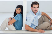 Unhappy couple are separated by white wall — Stock Photo
