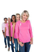 Group of women wearing pink tops and ribbons for breast cance — Stock Photo