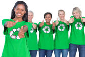 Team of female environmental activists smiling at camera and giv — Stock Photo