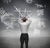 Anxious businessman losing at noughts and crosses — Stock Photo