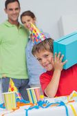 Little boy shaking his birthday gift — Stock Photo