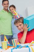 Little boy shaking his birthday gift — Stock Photo