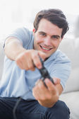 Portrait of a cheerful man playing video games — Stock Photo