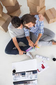 Overview of a man and his wife looking at house plans — Stock Photo