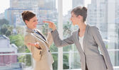Businesswoman pointing at her rival — Stock Photo