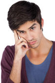 Thoughtful man with hand on face — Stock Photo
