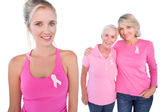Three happy women wearing pink tops and breast cancer ribbons — Stock Photo