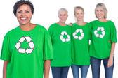 Happy women wearing green recycling tshirts — Stock Photo