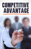 Businessman underlining the word competitive advantage — Stock Photo