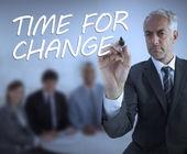 Stylish businessman writing time for change — Stock Photo