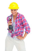 Smiling handy woman with a power drill — Stok fotoğraf