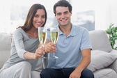 Portrait of lovers toasting their flutes of champagne — Stock Photo