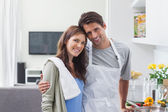 Lovely couple embracing in kitchen — Stockfoto