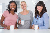 Friends having coffee together — Stock Photo
