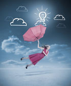 Glamour woman flying with a red umbrella — Stock Photo