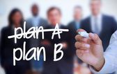 Businessman writing plan B with a marker — Stock Photo
