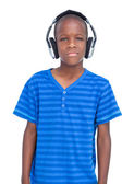 Little boy listening to music — Stock Photo