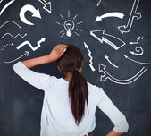 Rear view of a woman having an idea — Stock Photo