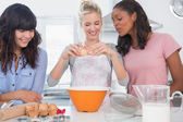 Cheerful friends making pastry together — Stock Photo
