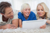 Son and his parents using a tablet — Stock Photo