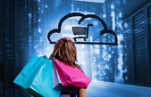 Woman in a data center holding shopping bags — Stock Photo