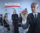 Sophisticated businessman underlining in red the word agenda — Stock Photo