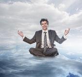 Businessman meditating — Stock Photo