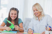 Mother and daughter doing arts and crafts together — Stock Photo