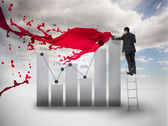 Businessman drawing a chart next to red paint splash — Stock Photo