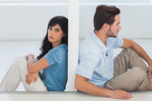 Sitting couple are separated by wall — Stock Photo