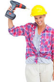 Funny handy woman with her power drill — Stok fotoğraf