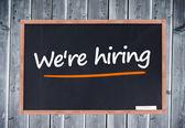 We're hiring written on blackboard — Stock Photo