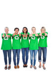 Team of happy female environmental activists giving thumbs up — Stock Photo