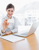 Pretty businesswoman showing blank business card — Stock Photo