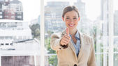 Smiling businesswoman giving thumb up to camera — Stok fotoğraf